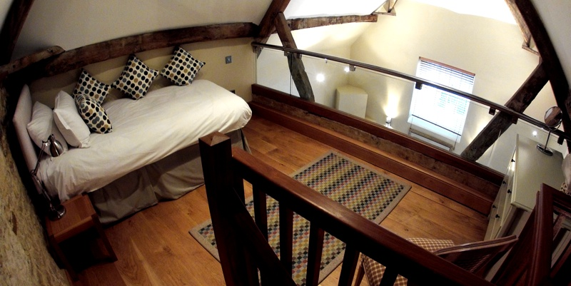 The mezzanine floor of the Coach House with single bed.
