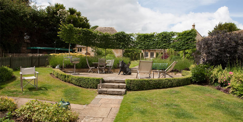 The stunning garden at Seymour House, with deck chairs and hog sculpture.